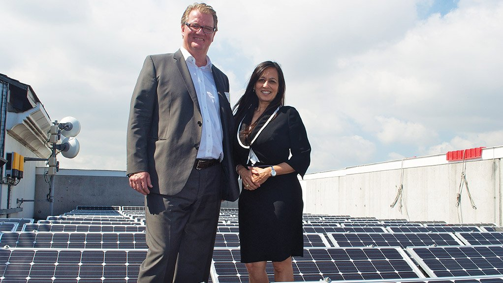 COMMERCIAL ADVANTAGE Vodacom's Chief Officer of corporate affairs, Maya Makanjee, and SolarWorld Africa MD Gregor Küpper on the solar-panelled roof of Vodacom's Century City building, in Cape Town