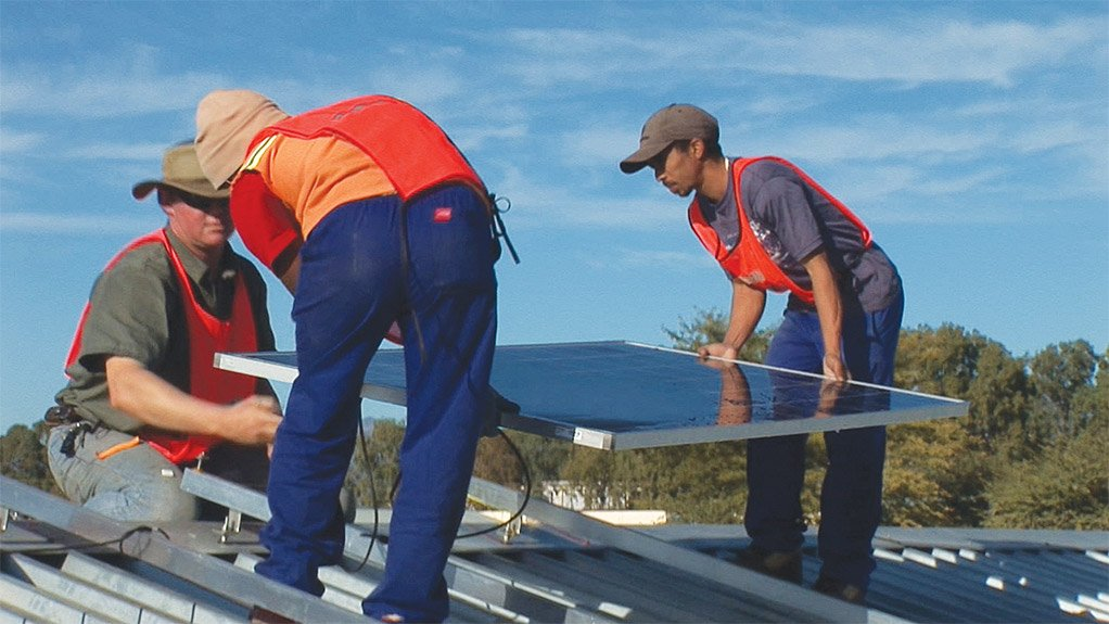 WORK OPPORTUNITY Workers installing solar panels to be used in an embedded generation project