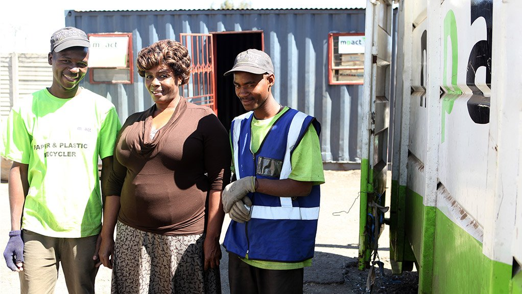 ENTREPRENEURIAL SPIRIT Khombisile Buthelezi, who received advice, training and equipment from Mpact before opening her business in January 2004, with her staff