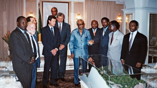 BRAZZAVILLE 1997 J&G team members present former Republic of Congo president Pascal Lissouba with a model of the proposed Sounda dam