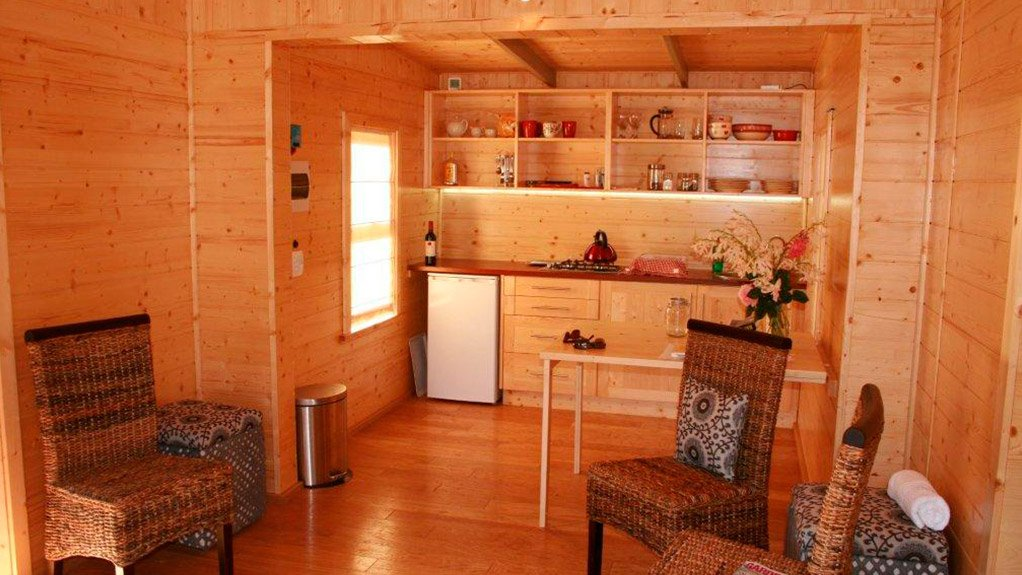 COMPACT LIVING The Rustic Eco Cabin makes full use of its 32 m2 footprint, which excludes the deck and outhouse