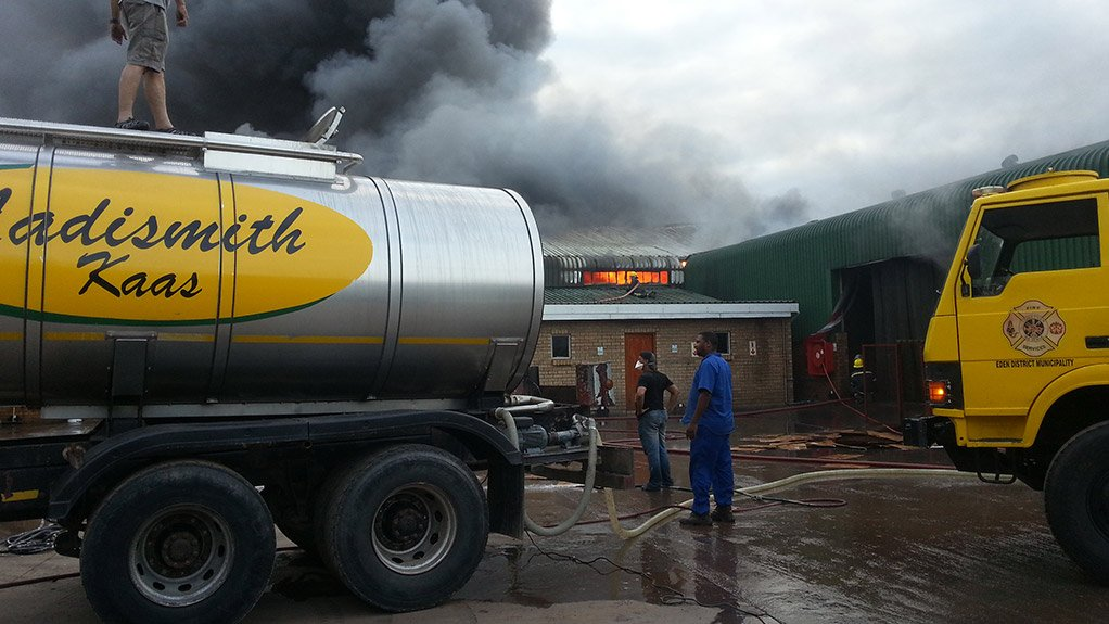 QUICK RESPONSE Fire fighters from Eden district municipality combat the fire that broke out in March at Ladismith Cheese