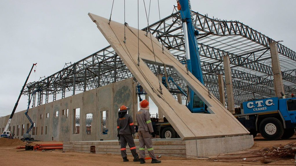 TILTING IT UP A crane erected the large wall panels that were cast in a horizontal position
