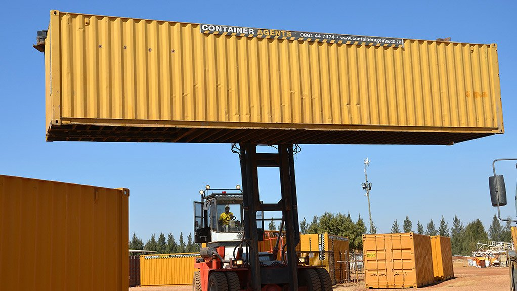 CONTAINER SOLUTIONS Container Agents has a special container-handling forklift truck, pictured here moving a 12 m unit
