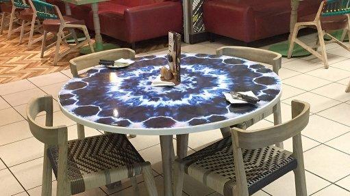 Enamel steel versatility displayed in new tables
