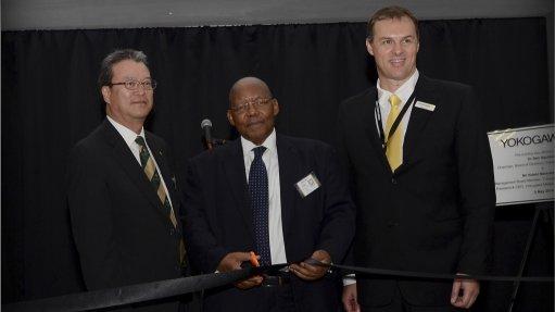 RIBBON CUTTING Celebrating to opening of Yokogawa South Africa's new office, is Yokogawa Middle East  and Africa president and CEO Hideki Matsubayashi, Eskom chairman Dr Ben Ngubane, and Yokogawa South Africa MD Johan Louw