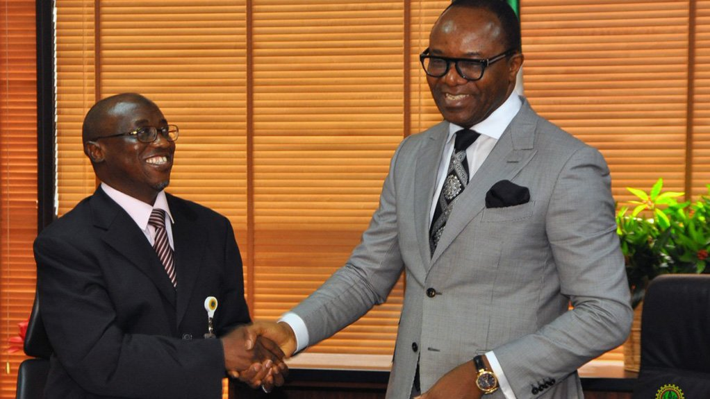 PASSING THE BUCK The beleaguered Nigerian National Petroleum Corporation's new MD Dr Maikanti Baru (right) shaking hand with Dr Ibe Kachikwu (left)