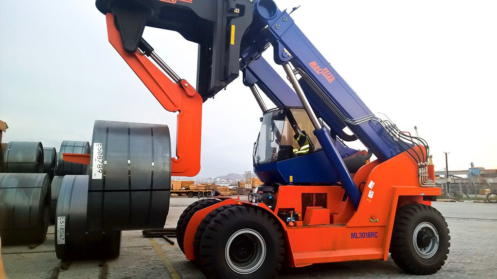 EASY LIFTING  The variable reach trucks are capable of easily lifting large rolls of materials