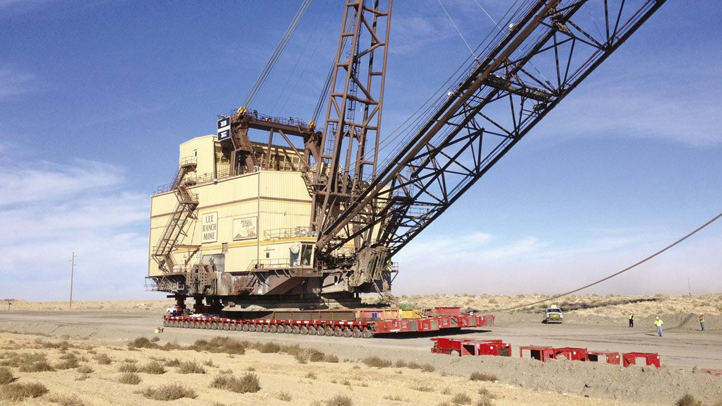 FULLY ASSEMBLED Mammoet uses a jacking system to lift the dragline and place it on a specialised transport system to move it to its new location
