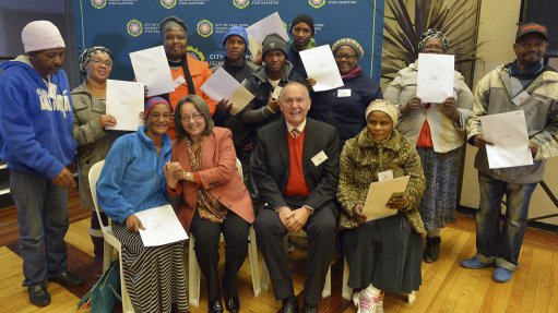 Think-tank hands over title deeds to residents of Western Cape town
