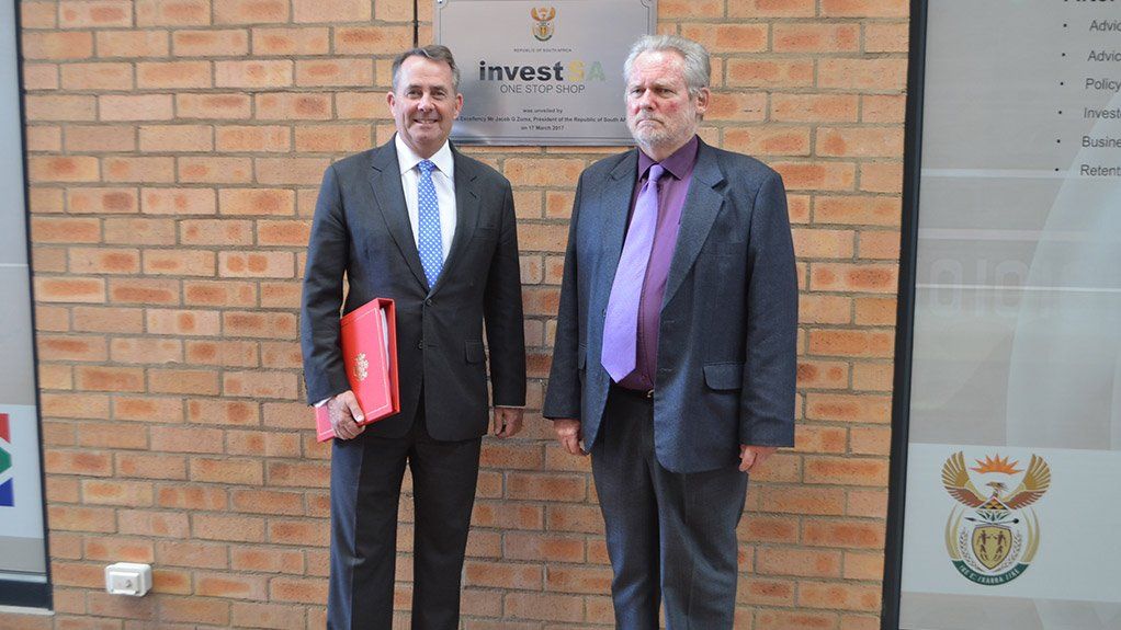 Dr Liam Fox (left) and Dr Rob Davies (right) outside the InvestSA One-Stop Shop in Pretoria