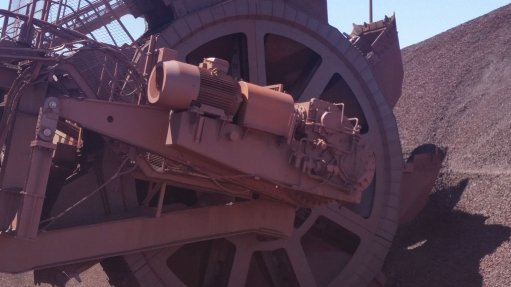 UPGRADE AND IMPROVE TAKRAF Africa's redesign of a bucket-wheel reclaimer features three bolted segments that enable maintenance to be carried out only on the worn parts of the bucket wheel