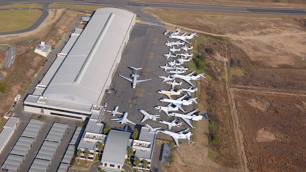 A wide range of business aircraft parked at ExecuJet's facility at Lanseria International Airport, north west of Johannesburg