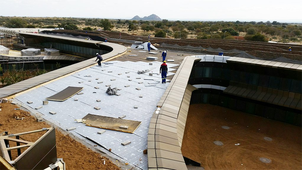 COMPLETE COATING The waterproofing of an expansive roof of one of the Botswana Innovation Hub campus' new buildings is about 90% complete