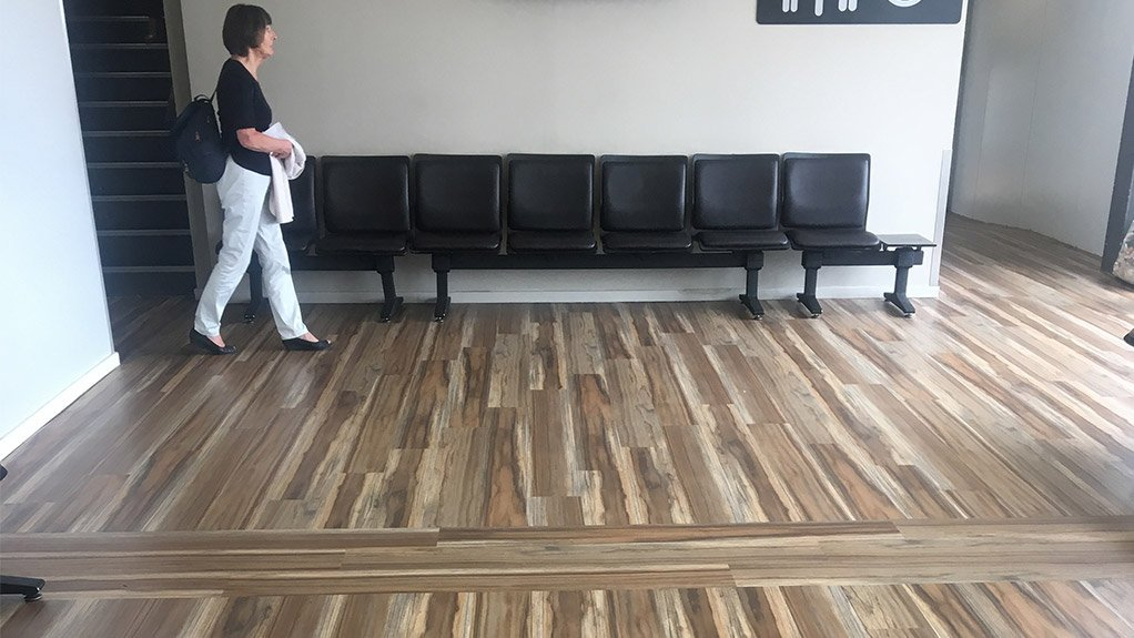 WELCOMING  The luxury vinyl tiles with wood effect transforms the departure lounge