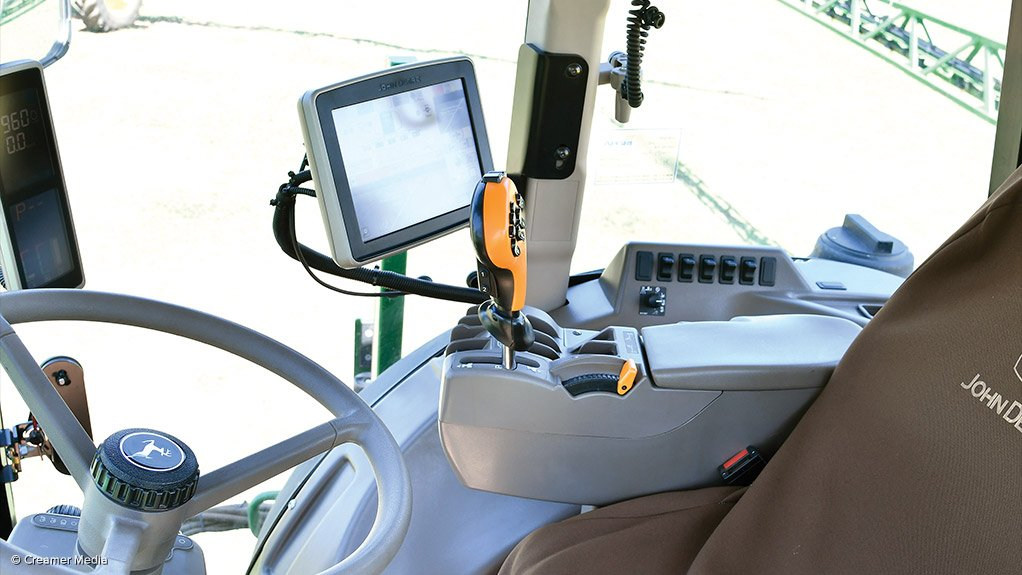 NO HANDS  John Deere's precision vehicles are self-driven, with an operator only for supervision monitoring