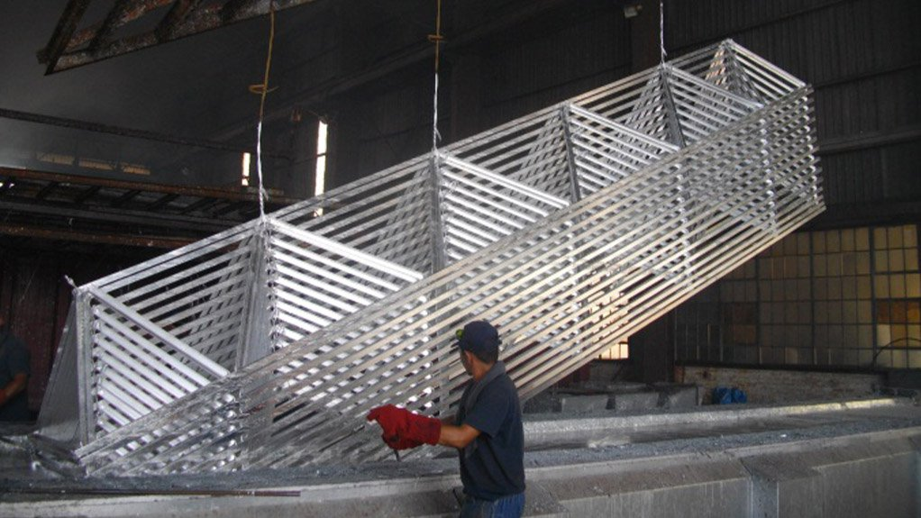 TAKE A DIP Dipping steel into molten zinc allows for an effective corrosion barrier