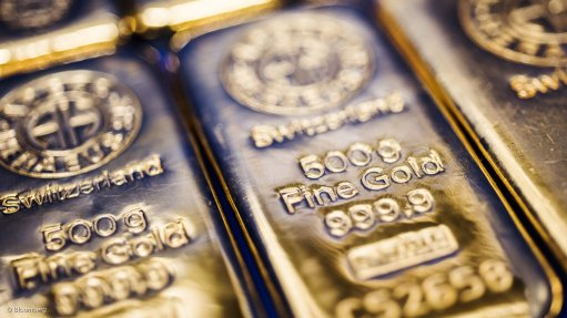 Gold spikes to more than 5-year high as Fed signals ready to cut