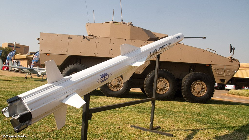 Some of the Denel Group's products on display – in the foreground, an Umkhonto naval surface-to-air missile, with a Badger infantry fighting vehicle behind, and just visible in the left background, a Seeker unmanned aerial vehicle