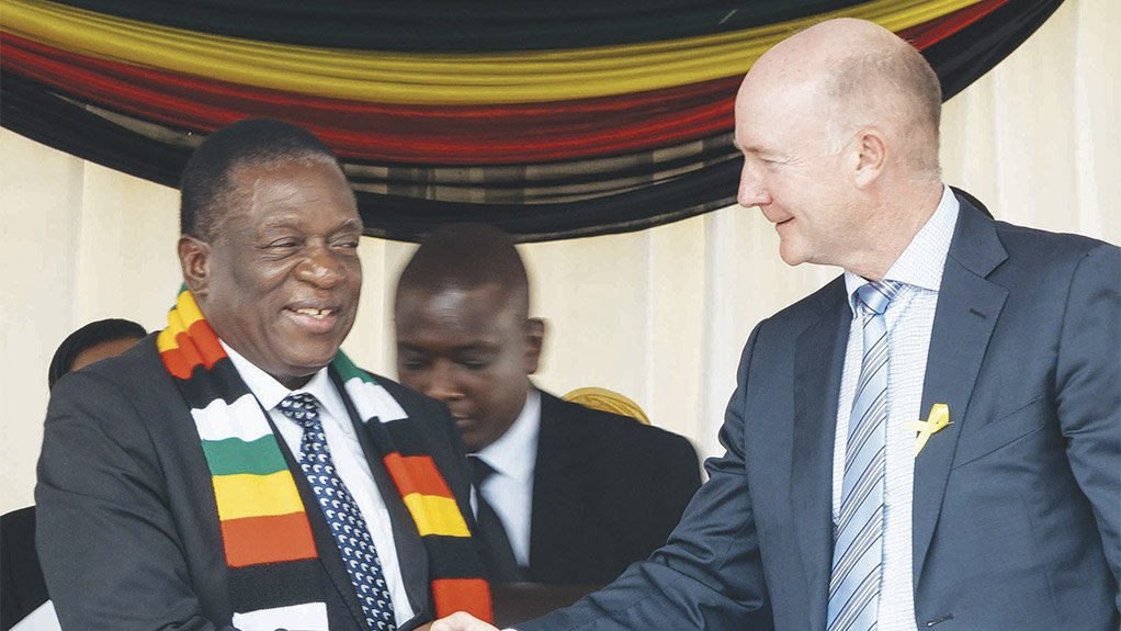 Caption:  FLASHBACK Zimbabwe's President Emmerson Mnangagwa shakes hands with Prospect Resources chairperson Hugh Warner at the ground-breaking ceremony for the Arcadia project in December