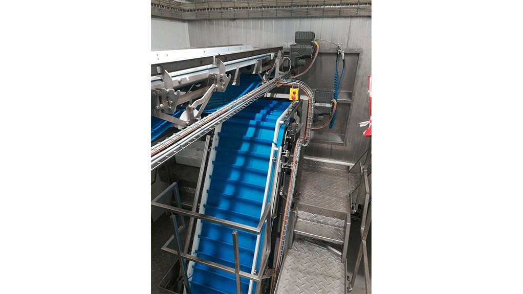 MIXING CONVEYORS The conveyor system consists of a central conveyor that is fed by eight smaller conveyors, each of which contain various frozen-food products to be mixed