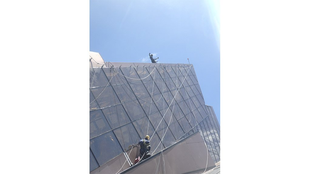 SEEING IT THROUGH Replacing large windows required not only expert work-at-height skills but also the measuring and cutting of specialised glass