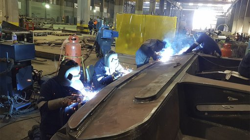 JOINING MODULES The vertical and overhead welding to join these modules were done with all- positional Flux-Core welding