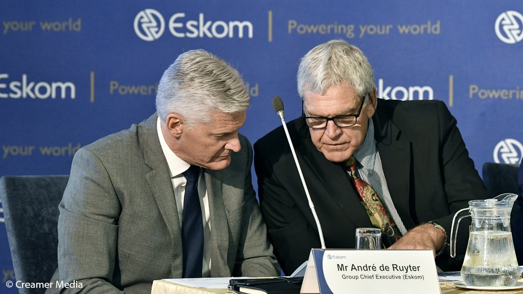 Eskom CEO Andre de Ruyter (left) consults with COO Jan Oberholzer during tate of system media briefing