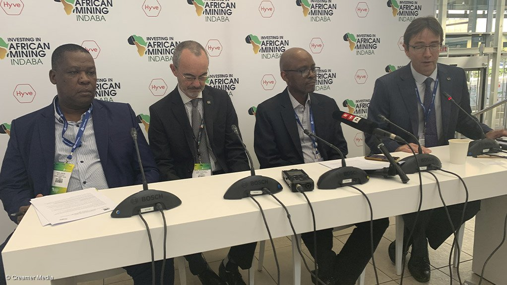 Minerals Council senior executive of environment, health and legacies Nikisi Lesufi, chief economist Henk Langenhoven, president Mxolisi Mgojo and CEO Roger Baxter participating in a discussion at the 2020 Investing in African Mining Indaba.