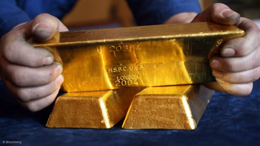 Gold pares weekly losses after weaker dollar brings relief