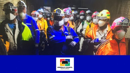 Morale high as Covid-masked South African miners get back to work