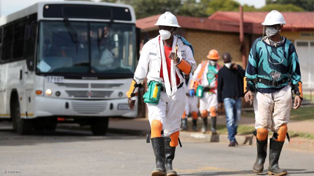Mineworkers wearing PPE
