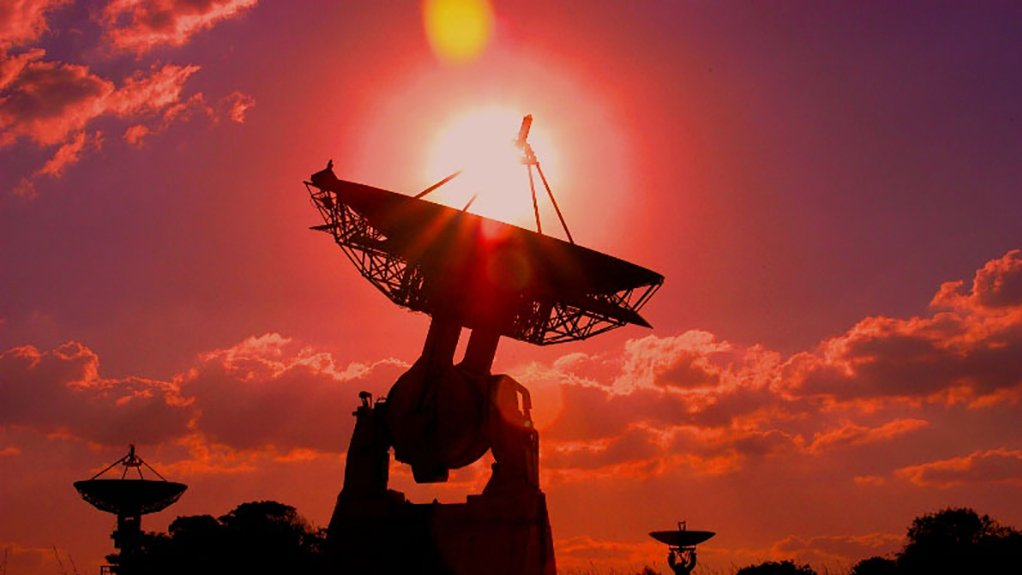 The rising sun silhouettes three of the dish antennas at SANSA Space Operations Hartebeesthoek complex