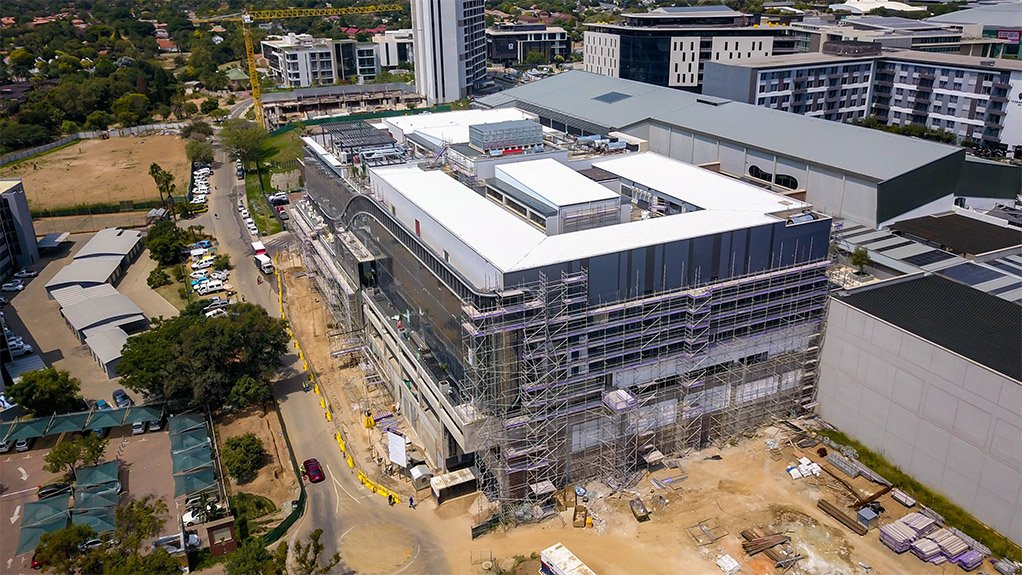 An exterior construction view of the Cintocare hospital