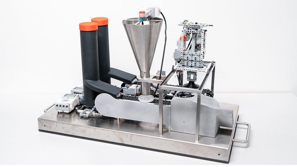 OPTIMA apprentices build miniature exhibition machine