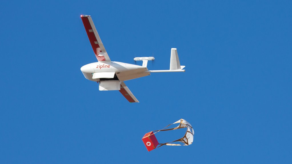 A Zipline fixed-wing drone drops a medical supply box