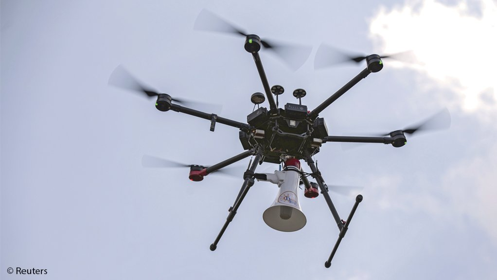Authorities use a multi-rotor drone to broadcast messages through a loudspeaker in Kigali, Rwanda