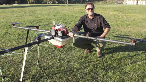 Kammanassie farmer Morné Jonker with the drone sprayer used to fight alien vegetation