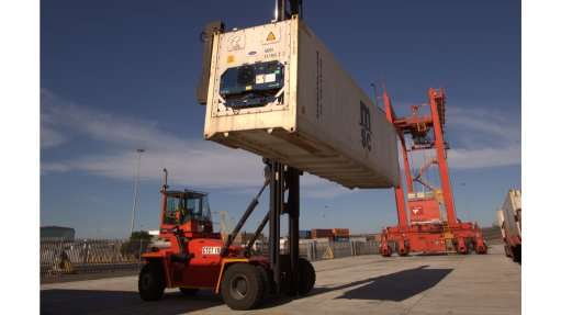 A forklift manoeuvres a reefer unit