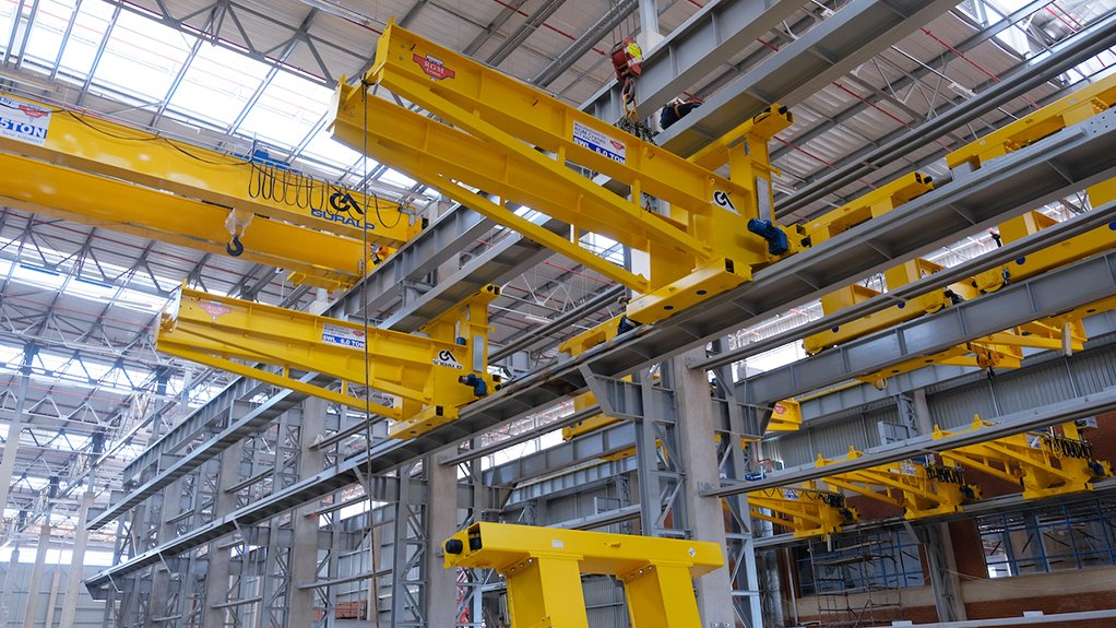 A JIB AND SHAKE Each jib crane is used to transfer the completed components to various operating lines along its travel length