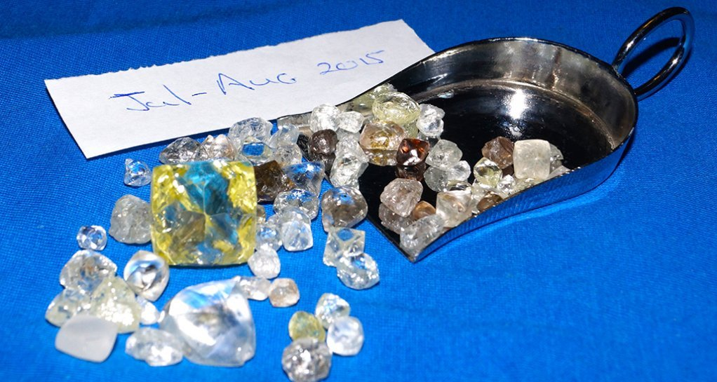 A month's worth of alluvial diamonds, showing the large one to cover expenses.