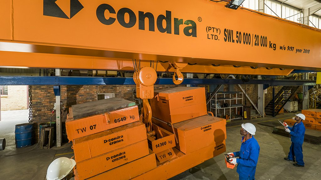 CRANE TEST A Condra overhead crane is used to move a test-weight that is the same weight and shape as the client's machine