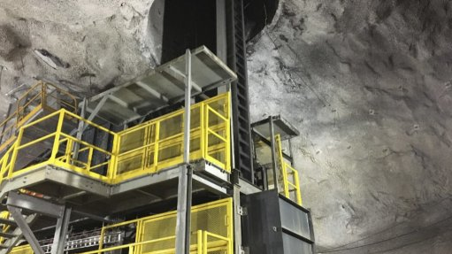 Underground loading station for a vertical conveyor