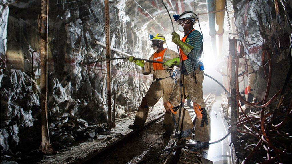 Harmony Gold mineworkers underground at Masimong gold mine.