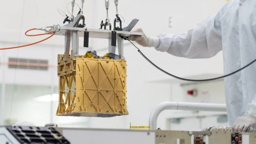 The Moxie instrument is lowered into its place in the Perseverance lander, during the latter's final assembly.
