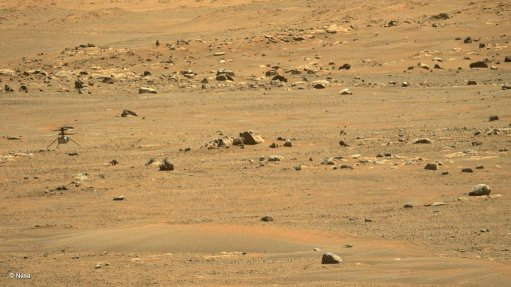 Ingenuity (far left) photographed at its current (second) landing site