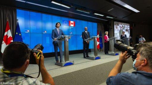 Justin Trudeau, left, Charles Michel, and Ursula von der Leyen speak following an EU and Canada summit in Brussels, on June 15.
