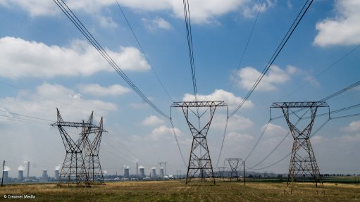 Power lines with Sasol's Secunda complex in the background