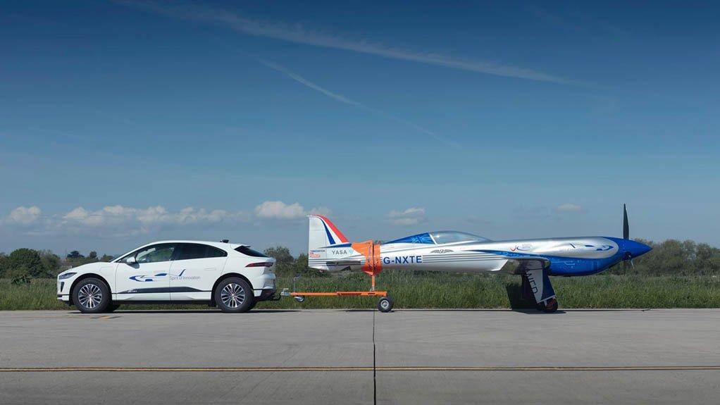 An image of a Jaguar I-PACE vehicle towing an electric aircraft
