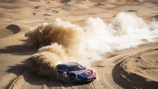 Porsche's newest electric car in desert terrain